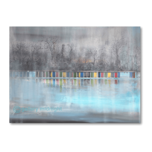 Picture of Tooting Lido in Winter. Grey skies, bare trees, colourful changing cabins and ice blue waters of the swimming pool