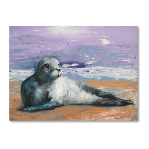 Baby Seal lying on golden sandy beach with his head up and white waves and purple sky in the background