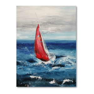 Sailing boat with red sail on choppy blue seas with grey skies