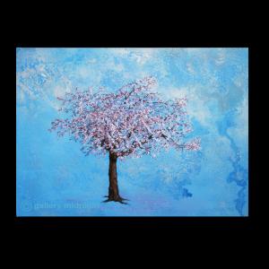 Japanese Blossome treem in full bloom against blue sky background